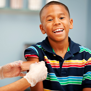 Young Boy Getting Flu Vaccination